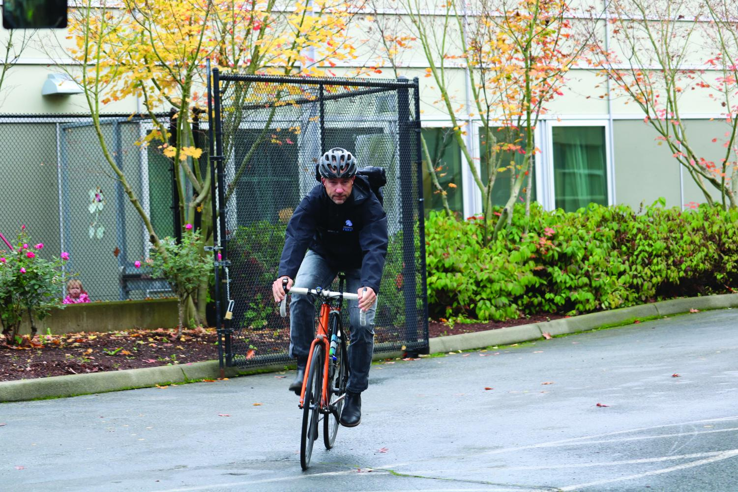 English teacher Alec Duxbury rides his bike. Duxbury rides his bike to school nearly every day -- he knows how important sustainable transportation is to the environment.