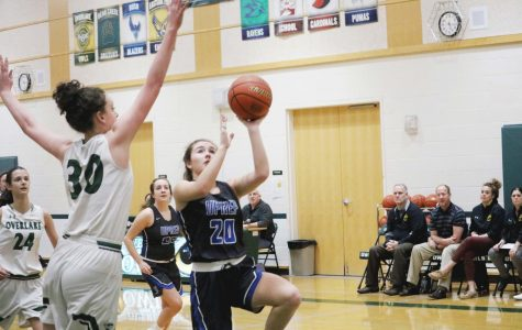 Sophomore Jane Morgan shoots a layup against Overlake Junior Eliza Friend.