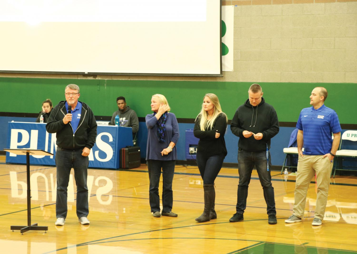 The Sanford family speaks at a University Prep Varsity Girls basketball game after the death of Raija Sanford. Pat Sanford, Raija's father, introduced Live Like Raija, an organization that strives to provide student athletes with the same immersion opportunities Raija recieved in her life.