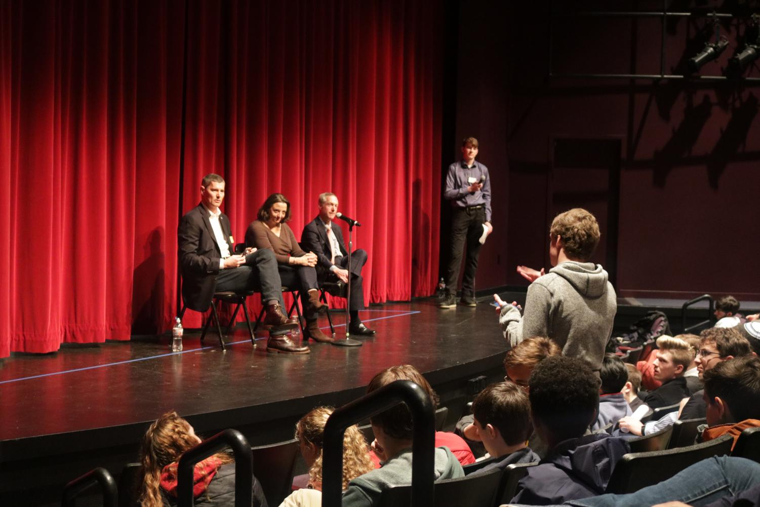 Senior John Higley asks a question to the panel from the Non-Liberal leadership track.