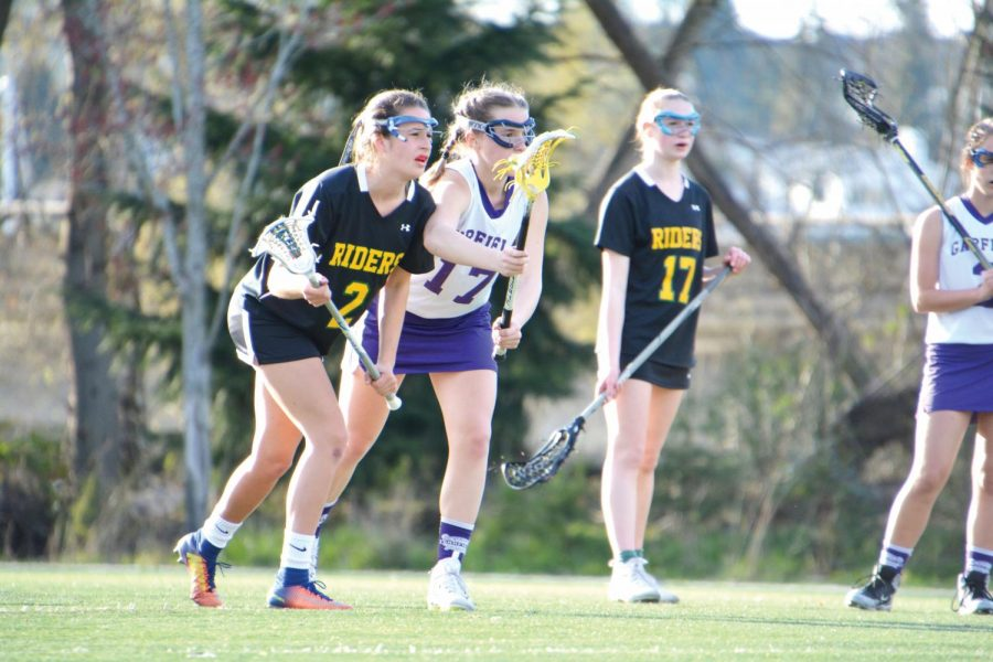 UPrep+students+who+play+lacrosse+must+find+outside++schools+who+field+teams.+Senior+%0ACourtney+Zell%2C+on+the+left%2C+playing+on+the+Roosevelt+team+against+Garfield.+