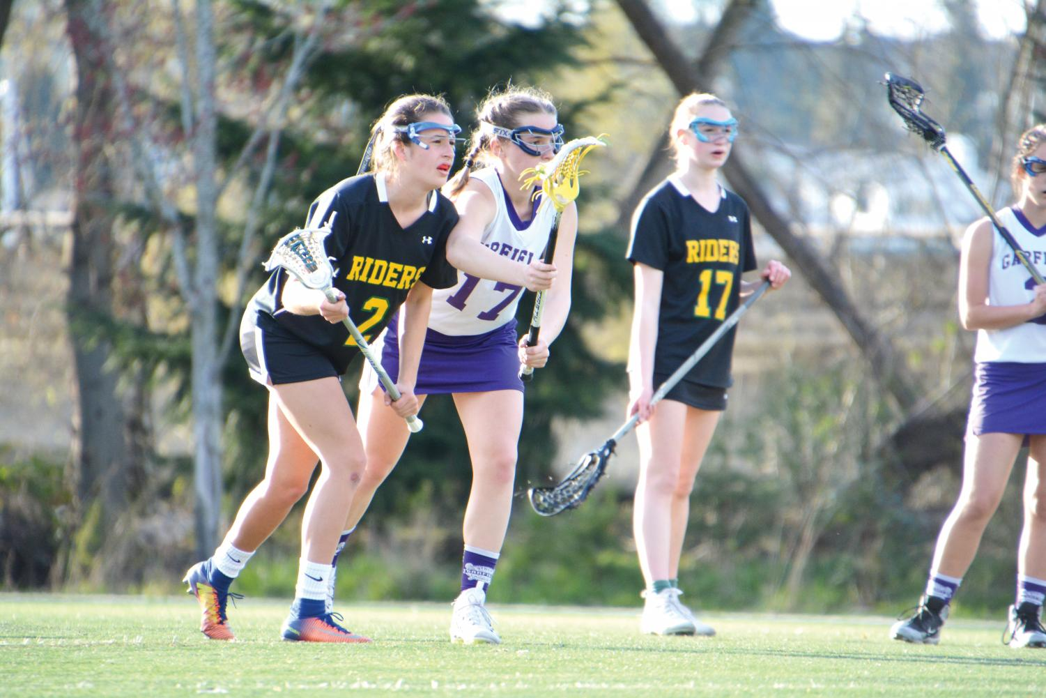 UPrep students who play lacrosse must find outside  schools who field teams. Senior  Courtney Zell, on the left, playing on the Roosevelt team against Garfield.