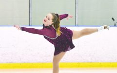 Sophomore Sarah Bunker performs a right forward outside edge spiral on the ice at a solo skating competition.