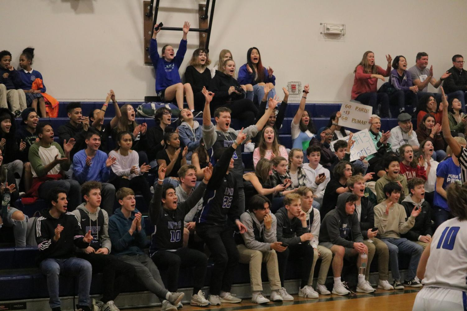 UPrep students celebrate while watching the varsity girls basketball game against Cedar Park. Over the past year, student attendance at sports games has gone up.