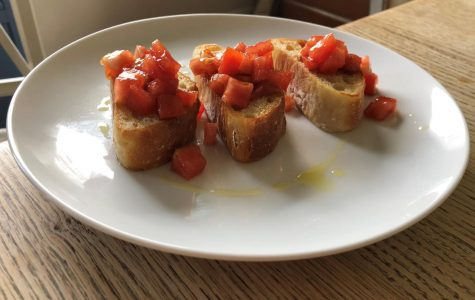 Snack: Bruschetta <br /> REVIEW: <br /> This was a super simple but super delicious appetizer. I used homemade baguettes, which are pretty simple (and you can follow this video: https://www.youtube.com/watch?v=m08i8oXpFB0&t=118s.).  <br /> THINGS TO REMEMBER: <br /> I cut up the baguettes and stuck them in a cast-iron pan with some olive oil for a couple of minutes on each side. I diced some tomatoes, tossed them with some balsamic vinegar and added them to the top of the baguette slices. I drizzled some olive oil, and voila!  <br /> FINAL VERDICT: <br /> These are definitely worth it. Baking the baguettes is definitely worth it — and it's super easy. You can also do this with store-bought bread, though, and it'll be nearly as good.