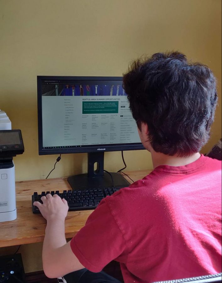 A student sifts through a list of summer programs found on the University Prep website. UPrep has a large assortment of resources available to students for finding summer opportunities.