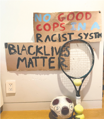 "Sports Equipment in front of a ""Black Lives Matter"" Poster. Professional athletes have played a big role in ongoing racial justice protests."