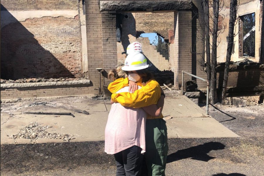 Commissioner of Public Land Hilary Franz and Mayor of Malden, Washington Chris Ferrel embrace in front of a destroyed post office. The town of Malden was completely burned to the ground in a few hours following the fires that erupted on Labor Day.