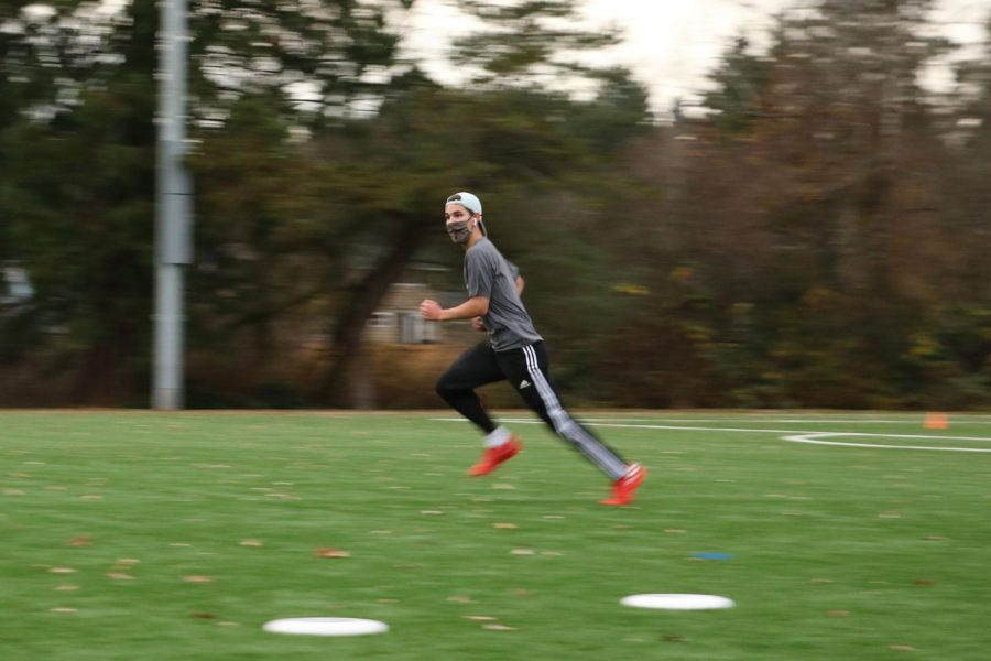 Senior Colton Anderson practices at a varsity ultimate frisbee POD on Dec. 3.