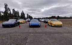 Cars lined up to drive at the autocross event held by the Porsche Club of America. Porsche Club Autocross events draw a wide range of cars, from a family commuter car, to a vehicle able to set track records across the world.