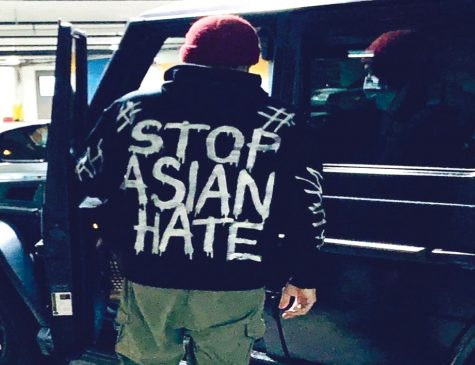 "Chinese teacher Juei-Chuan Hung heads to school wearing a hoodie he made in response to hate crimes against Asian Americans. ""I am wearing this hoodie because I was a little frustrated at how slow our school responded to the Asian hate crimes that [have] happened [in the past year] while the pandemic hit,"" Hung said."