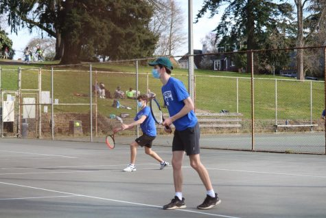 Boys' Varisty tennis duo Eli Pruzan and Carter Cast play South Whidbey in front of supporters on March 18, 2021.