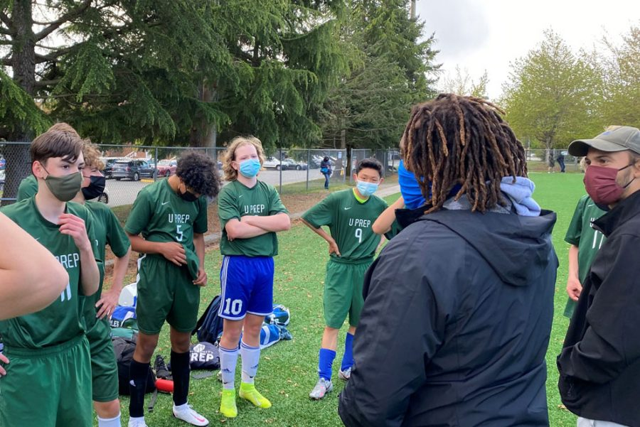 JV Coaches Darrel Marcelle and Andrew Walls speaking to the UPrep boys soccer team during halftime