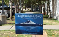 A Real Rent Duwamish yard sign reads, This land has a story. What role will you play?